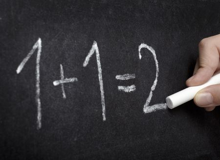 solve problems: closeup of chalkboard and simple math addition