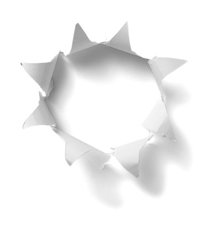 punch holes: hole in white paper background Stock Photo