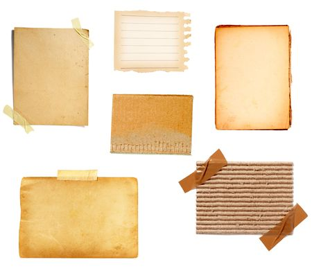 torned: collection of old note paper  on white background. each one is in full cameras resolution