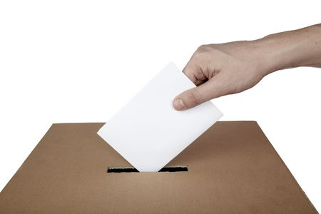 secrecy of voting: close up of hand and voting ballot Stock Photo