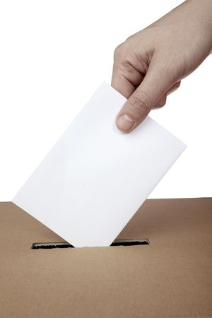 political system: close up of hand and voting ballot Stock Photo
