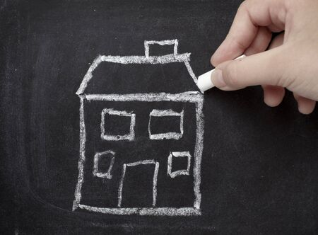 body built: drawing of house  on chalkboard  Stock Photo