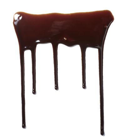 syrupy: close up chocolate syrup leaking on white background