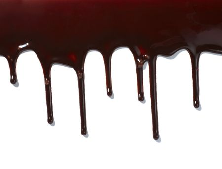 fudge: close up chocolate syrup leaking on white background
