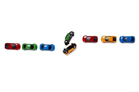toy cars in a row isolated on white background photo