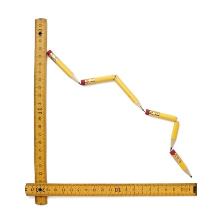close up of used pencil and ruler shaping finance graph on white background  photo