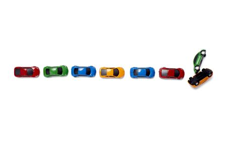 safe driving: toy cars in a row isolated on white background