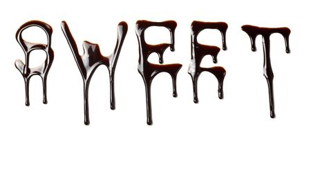close up chocolate syrup letters leaking on white background photo