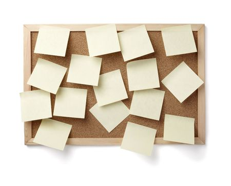 collection of various note papers  on cork board photo