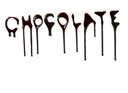 syrupy: close up chocolate syrup letters leaking on white background Stock Photo