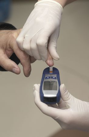 glucometer: close up of blood extraction and diabetes monitoring in lab