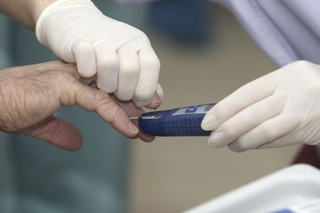 close up of blood extraction and diabetes monitoring in lab photo