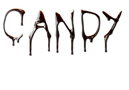 close up chocolate syrup letters leaking on white background Stock Photo - 6694109