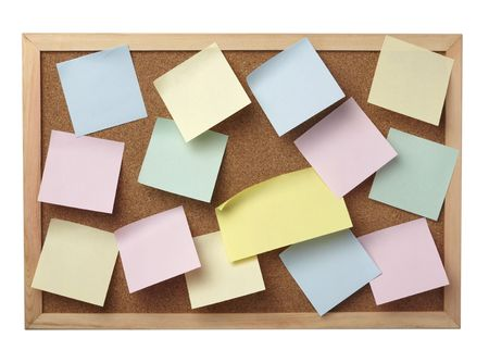 collection of various note papers  on cork board, on white background photo