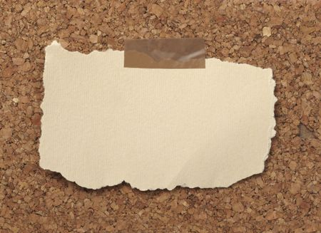 books on a wooden surface: closeup of note paper  on cork board