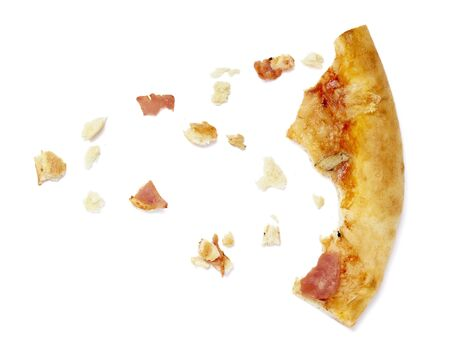 close up of pizza crumbs on white background photo