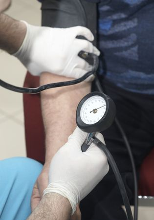 stress testing: close up of blood pressure  monitoring in lab