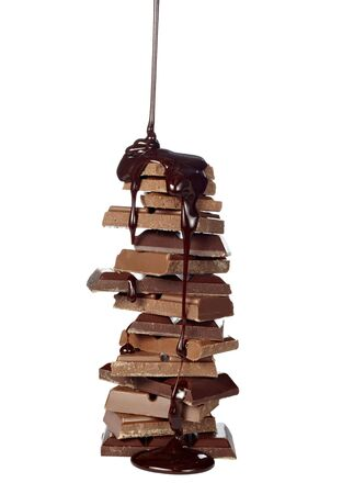 fudge: chocolate syrup leaking on stack of chocolate blocks Stock Photo