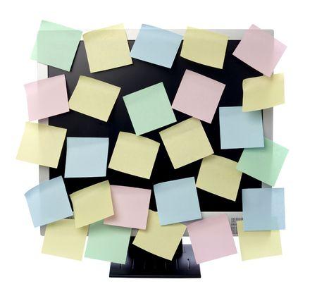 collectie van diverse notitie papier op de computermonitor Stockfoto