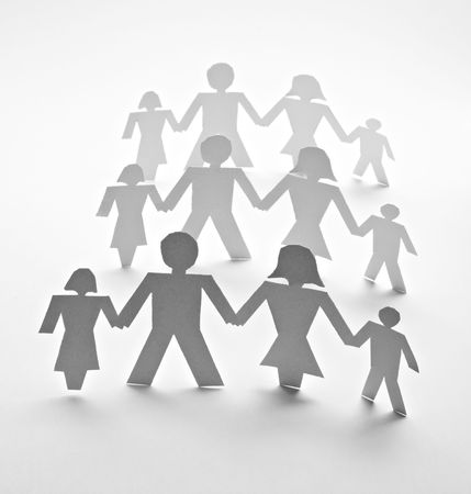 to cut out: close up of people cut out of paper on white background