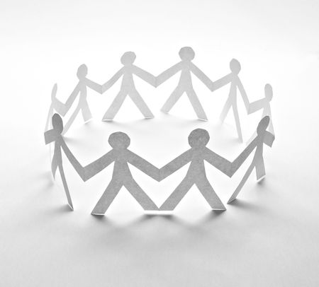 teamwork together: close up of people cut out of paper on white background