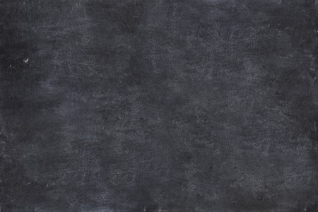 chalk board background: close up of a black dirty chalkboard