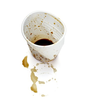 plastic container: close up of empty used coffee cups on white background