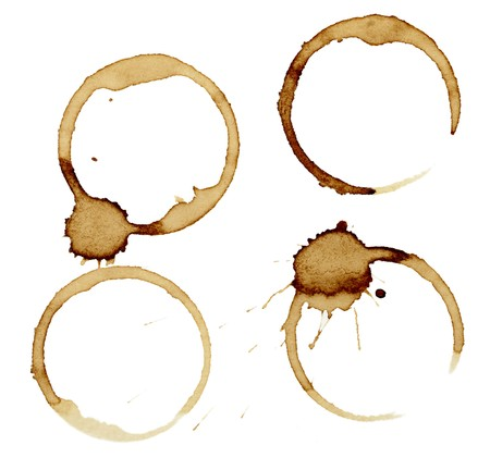 multiple stains: close up of coffee cup marks on white background  Stock Photo