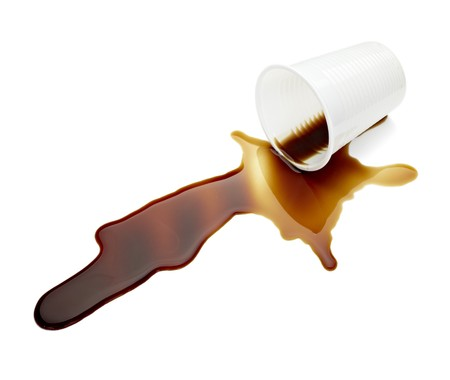 close up of spilled coffee on white background  photo