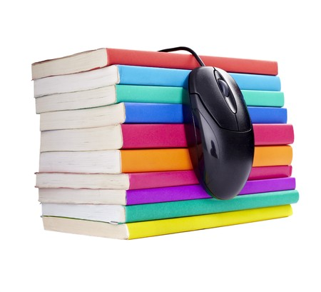 electronic book: close up of stack of colorful books and computer mouse on white background