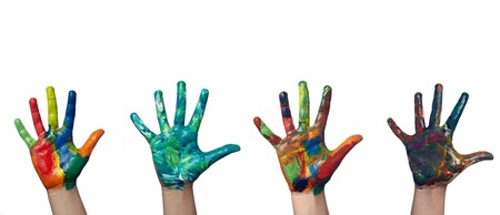 communication metaphor: close up of child  hands painted with watercolors on white background. each one is in full camera resolution Stock Photo