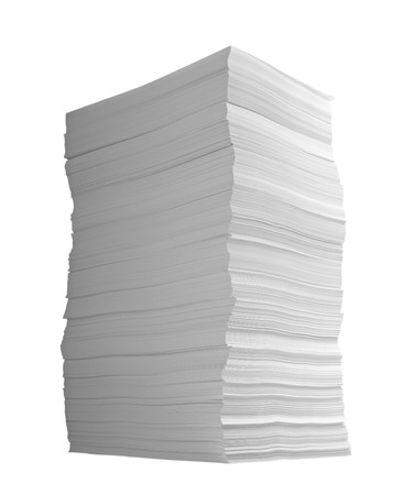 unorganized: close up of stack of papers on white background