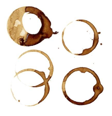 manchas de cafe: Close up de marcas de taza de caf� sobre fondo blanco
