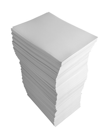 stacked up: close up of stack of papers on white background