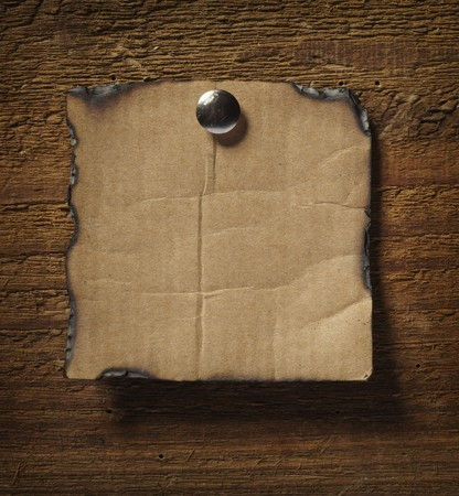 close up of grunge note paper on wooden background photo