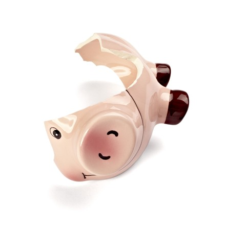 close up of a broken piggy bank on white background photo