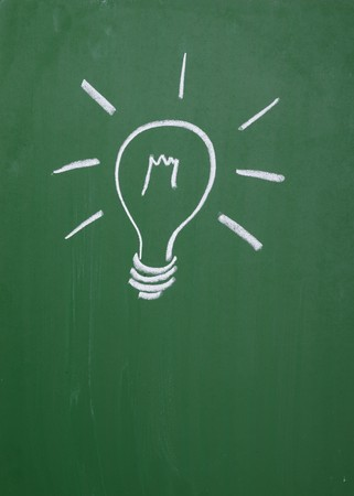close up of a light bulb drawing on blackboard Stock Photo - 7431702