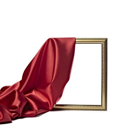 purple silk: Close up de marco de madera cubierta con seda pa�o con textura sobre fondo blanco  Foto de archivo
