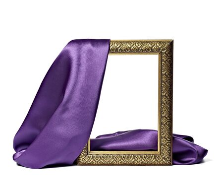 antique gold frame: close up of wooden frame cover with silk textured cloth on white background
