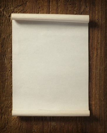 close up of grunge note paper on wooden background Stock Photo - 7431653