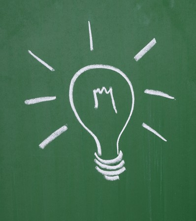 close up of a light bulb drawing on blackboard photo