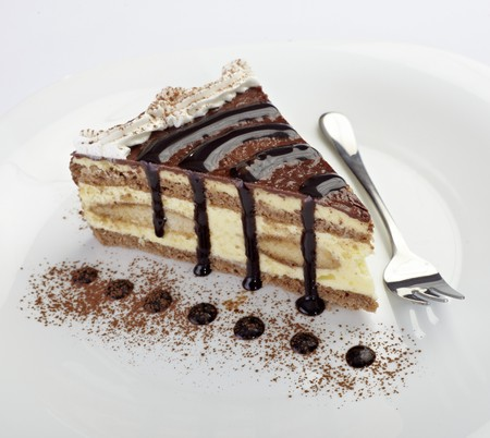 pastry: close up of cream cake on white plate