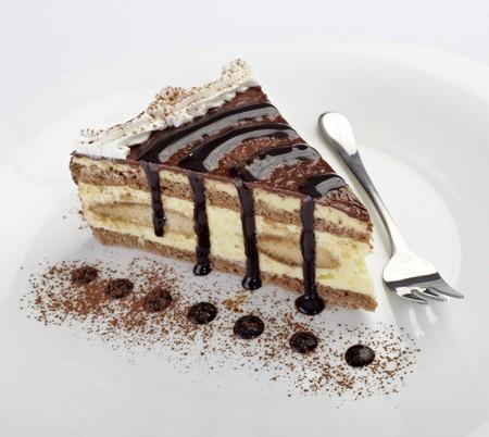 Feingeb�ck: Nahaufnahme von Creme Kuchen auf wei�en Teller  Lizenzfreie Bilder