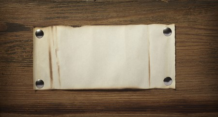 close up of grunge note paper on wooden background Stock Photo - 7513370