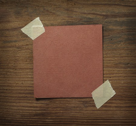 close up of grunge note paper on wooden background Stock Photo - 7625961