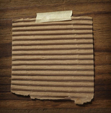 close up of grunge note paper on wooden background Stock Photo - 7625962