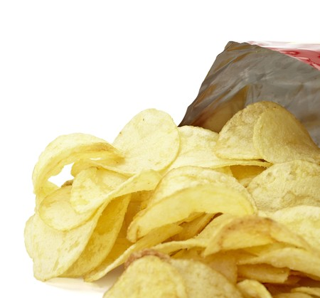 potato chip: close up of potato chips on white background