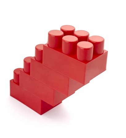 close up of child toy bricks construction on white baclground photo