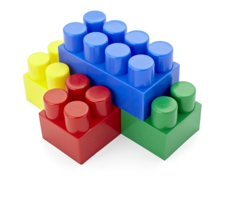 baclground: close up of child toy bricks construction on white baclground
