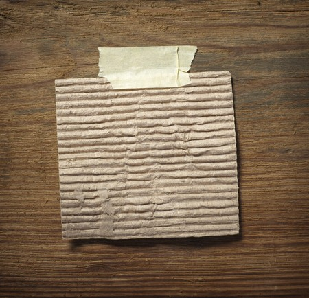 close up of grunge note paper on wooden background Stock Photo - 7706266